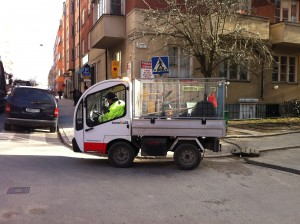 tiny swedish garbage collection truck
