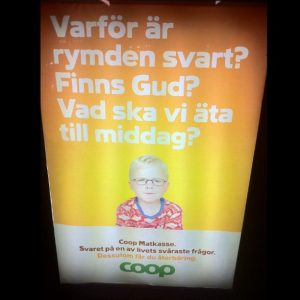"Grocery store ad at a bus stop. One of these questions is asked by Swedish kids but not American kids: ""Why is space black? Does God exist? What's for dinner tonight?"""